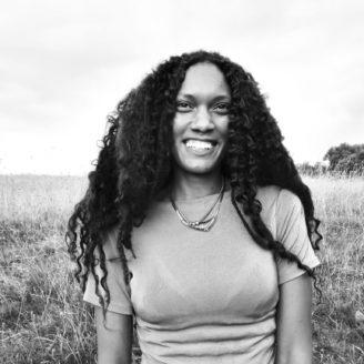 Natalie Hyacinth headshot in black and white